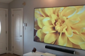 What are the benefits of using a Ceiling Ambient Light Rejecting UST material vs. a Flat Panel TV